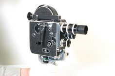 Paillard Bolex H16 16mm camera made in Switzerland in 1952.The H16 was the top-of-the-range Bolex cine camera, and was used both by wealthy, serious amateurs and professionals. Originally introduced in 1935, this particular model dates from 1951 or 1952, as evidenced by the single sprocketed sprocket rollers inside the camera (prior to this date the sprockets were on both sides).