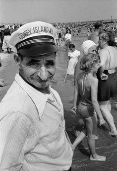by Harold Feinstein  Man Wearing Coney Island Hat, 1955