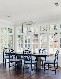 Sun Filled Dining Room Features A Hudson Valley Lighting Forsyth Pendant Illuminating An Espresso Stained Table Lined With Blue Faux Bamboo
