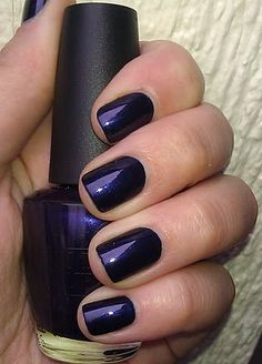 OPI Russian Navy. Need to find this polish, had my nails done with it for graduation, really pretty color. Can't tell here, but there's red glitter flecks in it, very subtle & classy