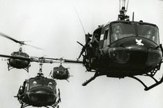 Bell UH-1 Huey Helicopter in Formation Flight in Vietnam