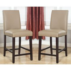 Add to the welcoming nature of your home with the Laura beige bonded leather counter stoool set. These chairs are constructed with poplar wood for strength and durability.