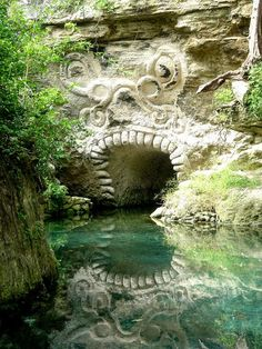 Mayan entrance in the caves of Xcaret, Riviera Maya, Mexico ~ Photo by raulmacias