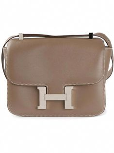 91bcebf77d0f00 View this item and discover similar shoulder bags for sale at - Hermès  Constance Bag. This beautiful Hermes Constance bag comes in Etoupe with  silver ...