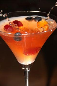 Kinky Martini...made with 1 part Kinky Liqueur (mango/passion fruit/blood orange) & 2 parts Absolute Mandarin, add fruit...