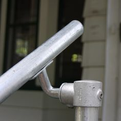 Building a pipe railing doesn't have to be difficult. Galvanized pipe railing allows you to build steel railings with relative ease. Porch Step Railing, Stair Railing Kits, Pipe Railing, Steel Railing, Porch Steps, Stair Steps, Front Steps, Homemade Curtain Rods, Outdoor Stair Railing