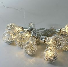 Light Bulbs – Shop By Bulb Type Dip your bulbs in glitter and give them a boosted up shine.