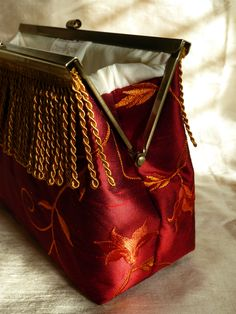 Embroidered Silk Clutch Bag made by Diane Shaw Silks © can now be purchased here: https://www.etsy.com/uk/listing/258050450/silk-clutch-bag-purse-embroidered-red?ref=shop_home_active_1