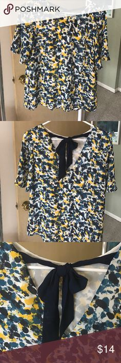 Printed top from H&M Loose short-sleeve printed top,  blue bow back closure. Navy, yellow, blue and white printed design H&M Tops