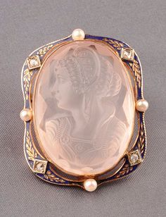 14kt Gold, Moulded Glass, Enamel, Diamond, and Seed Pearl Cameo, depiciting an Elizabethan lady, within blue enamel foliate frame set with diamond melee and pearls.
