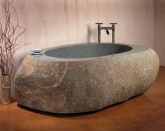 big rock soaking tub #interiors #bathroom reminds me of the red house with the tree growing out of it.