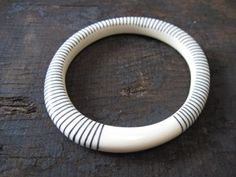 resin magnetic bangle - cream with black stripes