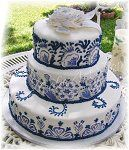 Dutch-inspired wedding cake with intricate Delft-pattern royal icing detail....