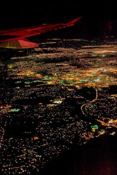 View from Airplane Coming in Low over Minneapolis at Night by Lee Rentz, via Flickr