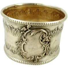 An antique French silver with Vermeil interior in the Rococo style.  Large monogrammed cartouche on the front surround by Rococo flourishes and beaded