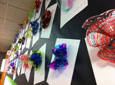 Chihuly Art, using heavy clear plastic plates, sharpies, and a heat gun.  First they had to create a hypothesis about what they thought was going to happen when the heat was applied to the plate.