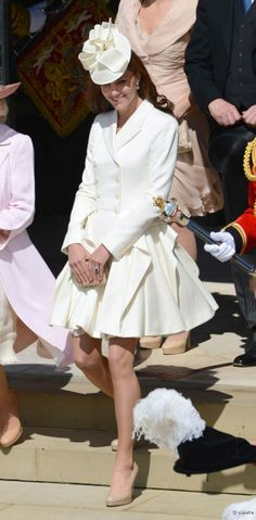 Kate in cream white pleated skirt with flaps