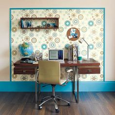 An eye-catching print on a patch of wall can designate a portion of a room for a distinct task. Here, it's a home office for computing in a bedroom. |  Photo: Dan Duchars/IPC Images | thisoldhouse.com