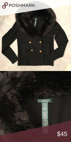 Ralph Lauren Sweater with Huge Faux Fur Collar Classic Ralph Lauren black sweater with a huge, thick faux fur collar.  The body of this sweater is 100% lambswool. Gold buttons finish this off nicely.  In perfect condition, except the two bottom buttons are missing.  Looks fine without them, but if you want a 8-button front, it's as easy as buying 2 new buttons.  I didn't bc I like it this way.  Price already considers the missing buttons. Ralph Lauren Sweaters Cardigans