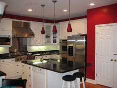 painting my kitchen red on two opposite walls. the cabinets are