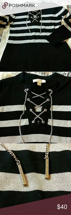"""MICHAEL KORS BLACK SILVER KNIT SWEATER M GENTLY USED SILVER BLACK SWEATER LACE UP FRONT LOGO TASSELS GORGEOUS 60% COTTON 40% VISCOSE 5% MATALISK BUST 40"""" WAIST 34"""" LENGTH 28"""" SLEEVES 25"""" VERY LOVELY. Michael Kors Sweaters"""