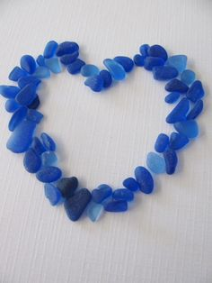 Sea glass heart - pretty way to work in accent colors (like the royal, indigo, Sodalite Blue or Dazzling Blue shown here) for your wedding, party, or other event decorating!