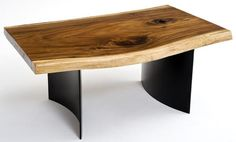 This unique coffee table design features a solid wood slab with natural edges set on a forged metal curved base for a modern style. Live edge wood. Custom sizes