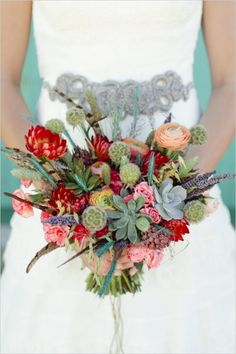 feather succulent and floral bouquet #desertwedding #southwestwedding #weddingchicks http://www.weddingchicks.com/2014/01/01/vibrant-desert-wedding-inspiration/
