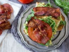 BLAT Toast : <p><b>What You'll Need:</b>1 ripe avocado   1/2 lime   2 slices crusty toasted bread   1/2 cup baby arugula   4 thin slices tomato   4 slices thick sliced bacon, cooked crispy</p>  <p></p>  <p><b>What to Do:</b>Cut avocado in half and remove the seed. Squeeze lime juice in each half of the avocado. Mash in its shell and spread over both slices of toast. Top each piece of toast with 1/4 cup baby arugula, 2 slices tomato and 2 slices bacon.</p>