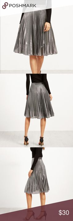 """Silver Pleated Skirt Fabric:Fabric has no stretch Color: Silver Length: Knee length  Material:100% Polyester Silhouette: pleated  SIZE CHART: Based on approximate body measurements.  SMALL Length: 25.5"""" / 65 cm Waist: 25"""" / 64 cm  Accepts Reasonable Offers!  Thank You for Shopping with Rebel Chic! rebel chic Skirts Midi"""