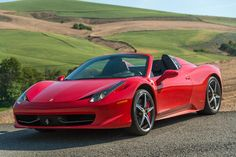 The 2014 Ferrari 458 Spider is beautiful to behold, brilliant to drive, and truly one of the few supercars in the world that is controllable and livable. Ferrari 2017, Ferrari 458, Motor Works, Coffee Lover Gifts, Digital Trends, Car Brands, Car Manufacturers, Motor Car, Cars And Motorcycles