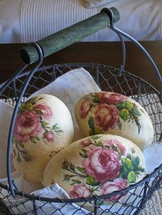 Really beautiful eggs with roses on them in a basket. What a lovely display.