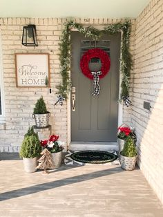 See how one red wreath inspired a welcoming front entry. Winter Holidays, Happy Holidays, Christmas Holidays, Christmas Decorations, Xmas, Christmas Porch, All Things Christmas, Vintage Christmas, Porch Decorating