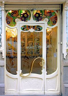Art Nouveau Drugstore Entry Door at Villarroel 053 b, Sant Antoni, Barcelona, Spain.