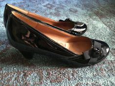 Sofft black patent leather heels. With buttons and bow detail.  Size 9. 2 inch heel.  Worn once. Very good condition.