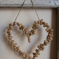 Decorative handmade heart made from peanuts with natural jute twine attached for hanging. Each peanut is drilled and placed on pliable, strong wire and moves independently of each other. Can be bent into your desired shape. Hang in your kitchen or outd...