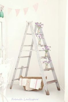 I also like the vintage look of this ladder with the chipped paint on the bottom.