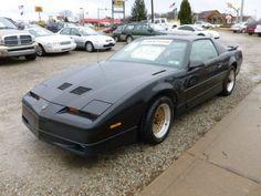 Black Pontiac Firebird GTA Trans Am.