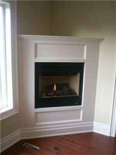 corner gas fireplace surround ideas - Google Search