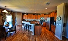 Open kitchen from @lennarcharnc! We love the abundant cabinet space and the large island/breakfast bar!