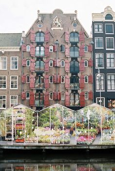 The Netherlands Travel Inspiration - Greenhouses on the Water in Amsterdam |