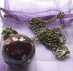 Just finished my purple resin and gold flakes glass dome pendant for my etsy Shop.