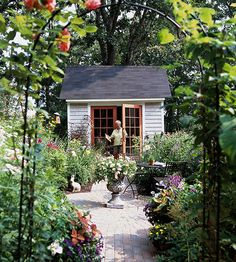 Every backyard should include a garden shed to store tools, equipment, and pots. Why not build or buy a wooden shed that can be customized to meet your needs? They can include a potting bench, storage area, and even a spot for entertaining or relaxing. Plus they can be painted to complement your home. In this pretty backyard, a small shed with French doors becomes a garden focal point./