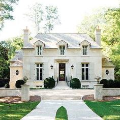 Atlanta Homes & Lifestyles - home exteriors - french chateau, french home exterior,  Stanley Dixon & Betty Burgess - Gorgeous French stone home