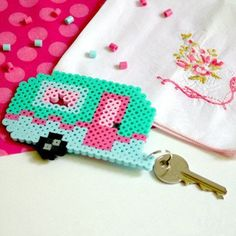 Tote your camper keys in style with a retro camper keychain. FREE perler bead pattern!
