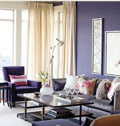 Dark Purple and White Walls with Gray and Blue Furniture