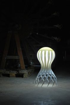 """Inspired by the unusually-shaped sea creature it's named after, CIRRATA, a suborder of octopuses, is a glowing, delicately formed lamp designed by Markus Johansson that is meant to light up the """"darkness of the ocean."""""""