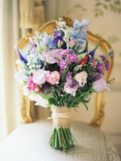 Lisianthus, delphinium, Veronica and tiny blooms look wild and lovely: http://www.stylemepretty.com/2015/07/08/23-gorgeous-wildflower-inspired-bouquets/