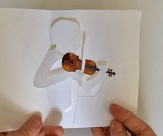 Printable DIY pop-up card of violinist who really seems to be playing the…