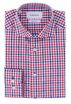 Esta camisa es roja y azul. La camisa es formal. Quiero la camisa para ir a la iglesia. Puedo llevar la camisa con pantalones negroes.